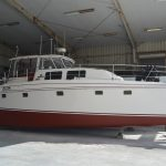 white red hull boat purchased